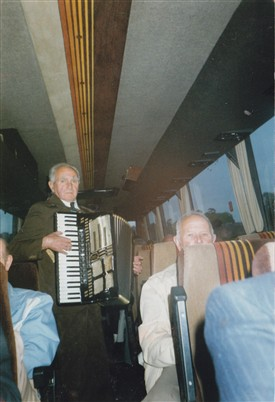 Photo:Sam entertaining on a coach trip