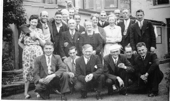 Photo:A Loganlea pub trip in the 1950s?  Back Row (L-R): Peter Corrigan ?; two unknowns;  - Dougan; Andrew - ; Johnnie Kelly; T.B.; Billy Smith.  Front (L-R): Hughie Brown; Paddy Mulligan; Willie Walker; Jock Walker; Dan McGuigan; Danny Young.