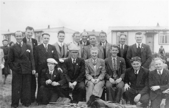 Photo:Loganlea Gala Day Committee 1949 in front of the pre-fabs that were down from the present Post Office.