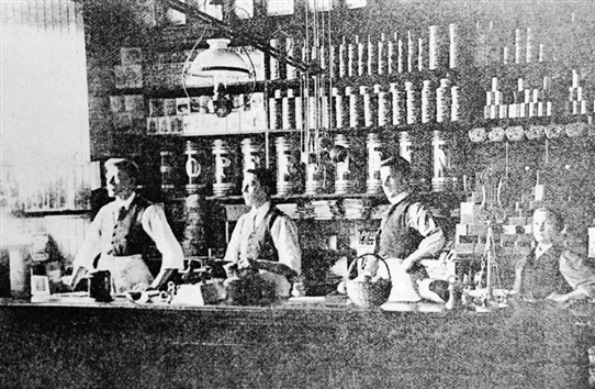 Photo:Some of the shop assistants behind the counter in the grocery department of the Co-op.