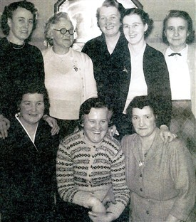 Photo:Community Club Committee, Addiewell, 1950s.  Back Row (L-R): Mrs Meg Muirhead, Mrs M. Corrigan, Mrs M. Kane, Mrs G. Lynch, Mrs McColl.  Front Row (L-R): Mrs Cameron, Mrs Scott, Mrs M. Brown.
