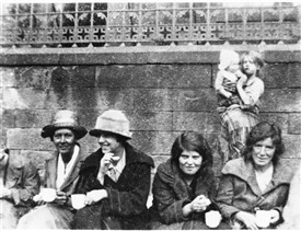 Photo:Women sitting outside the West Calder Parish Office (now the dental surgery across from Wood's garage).  They were protesting that the Parish Council had decided to cease payments to striking miners.